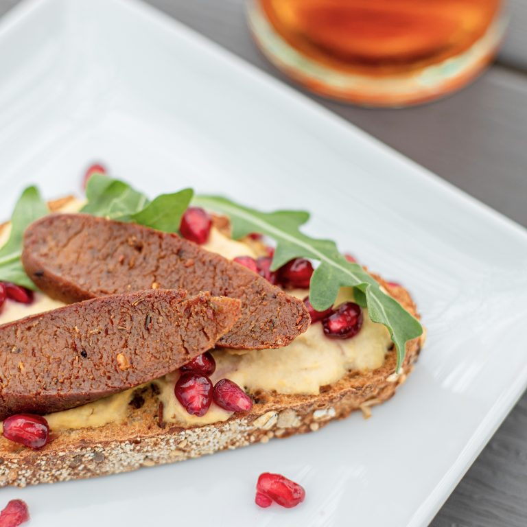 Lemon Hummus Sausage Toast with Arugula and Pomegranate Seeds