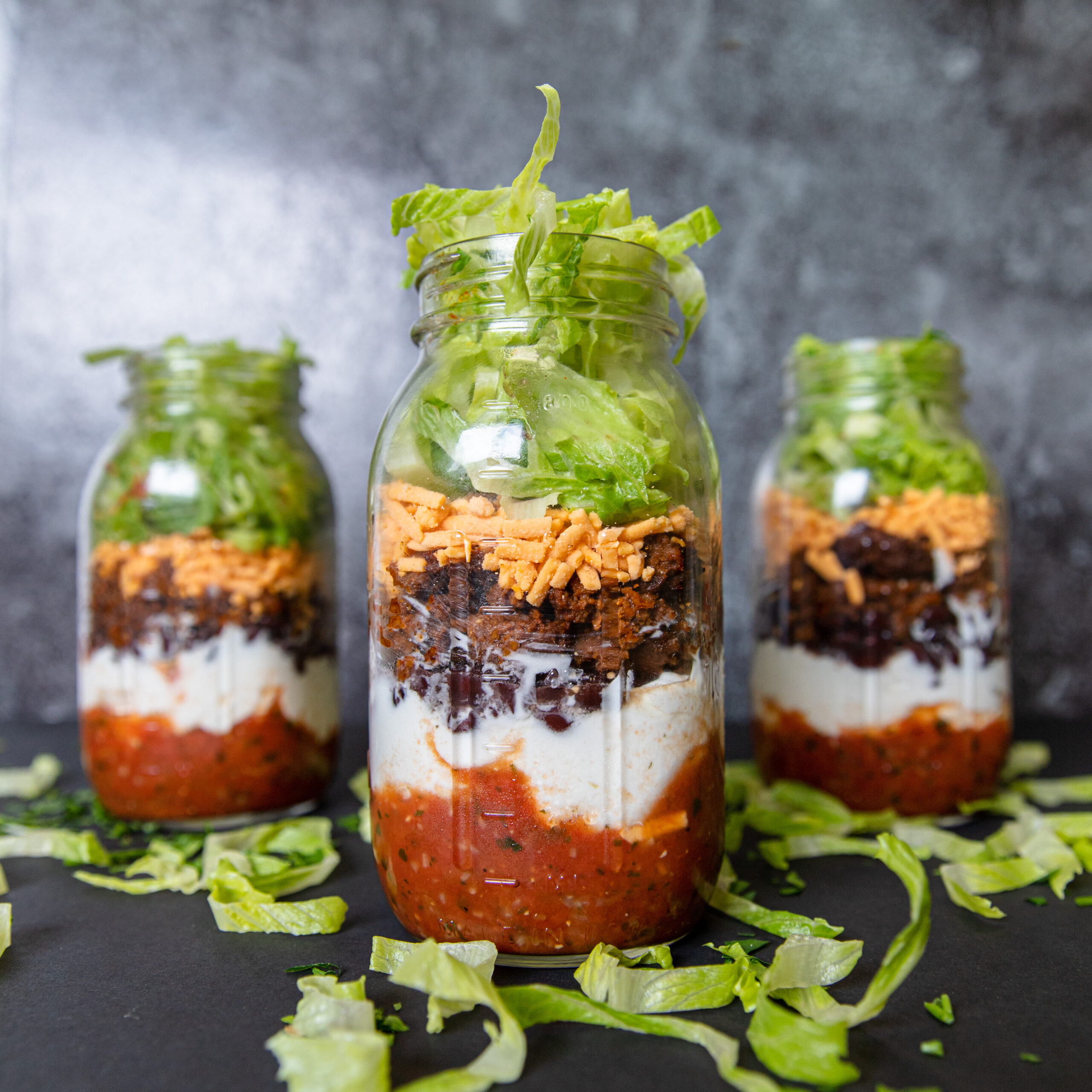 Vegan taco salad jars made with No Evil Foods El Capitan Chorizo Crumbles